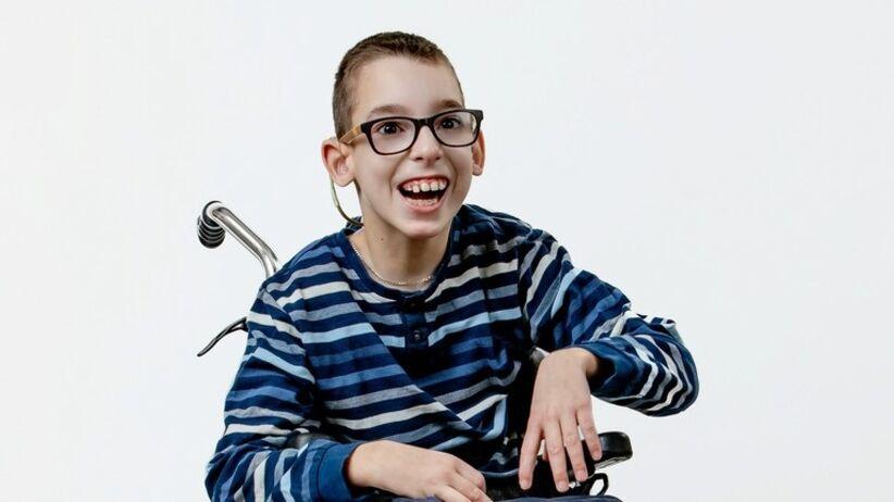 Chłopiec na wózku